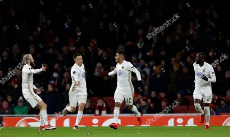 Ostersunds' Hosam Aiesh, center, celebrates after the own goal by Arsenal's Calum Chambers during the Europa League Round of 32, second leg soccer match between Arsenal and Ostersunds FK at the Emirates Stadium in London