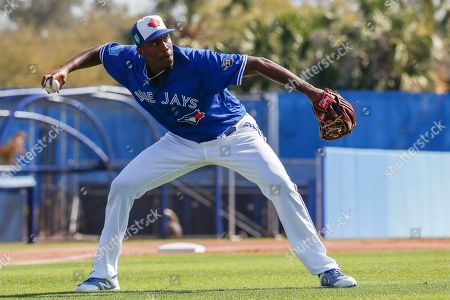 Toronto Blue Jays relief pitcher Carlos Ramirez practices a drill during spring training baseball, in Dunedin, Fla