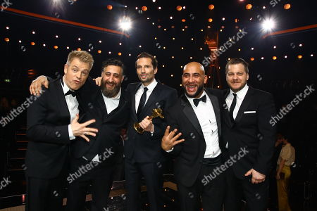 (L-R) Michael Mittermeier and the crew of '4 Blocks' during the 53rd annual 'Goldene Kamera' (Golden Camera) film and television award ceremony in Hamburg, Germany, 22 February 2018.