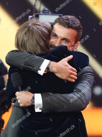 Actor Louis Hofmann (front) hugs Edin Hasanovic (R) after receiving the newcomer award during the 53rd annual 'Goldene Kamera' (Golden Camera) film and television award ceremony in Hamburg, Germany, 22 February 2018. Liam Neeson was awarded for his lifetime achievement.