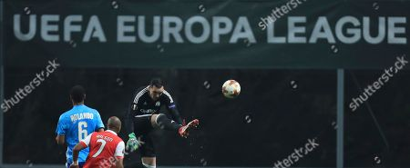 Marseille goalkeeper Yohann Pele clears the ball during the Europa League round of 32 second leg soccer match between SC Braga and Olympique de Marseille at the Municipal stadium in Braga, Portugal