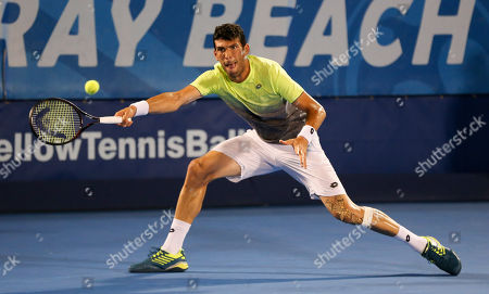 Franko Skugor, from Croatia, plays a forehand against Hyeon Chung, from Korea, during the Delray Beach Open ATP professional tennis tournament, played at the Delray Beach Stadium & Tennis Center in Delray Beach, Florida, USA. Hyeon Chung won 6-4, 7-6 (4)