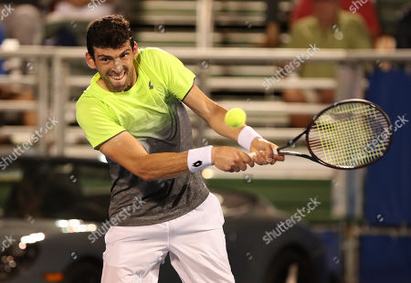 Franko Skugor, from Croatia, plays a backhand against Hyeon Chung, from Korea, during the Delray Beach Open ATP professional tennis tournament, played at the Delray Beach Stadium & Tennis Center in Delray Beach, Florida, USA. Hyeon Chung won 6-4, 7-6 (4)