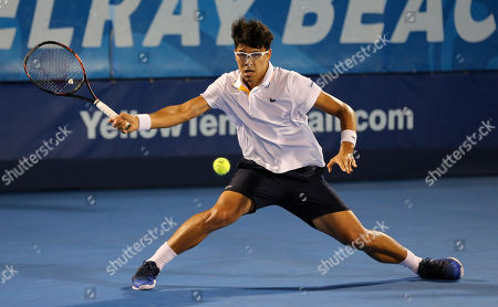 Hyeon Chung, from Korea, slides to play a forehand against Franko Skugor, from Croatia, during the Delray Beach Open ATP professional tennis tournament, played at the Delray Beach Stadium & Tennis Center in Delray Beach, Florida, USA. Hyeon Chung won 6-4, 7-6 (4)