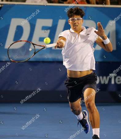 Hyeon Chung, from Korea, hits a forehand against Franko Skugor, from Croatia, during the Delray Beach Open ATP professional tennis tournament, played at the Delray Beach Stadium & Tennis Center in Delray Beach, Florida, USA. Hyeon Chung won 6-4, 7-6 (4)