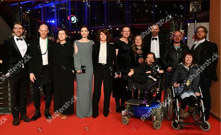 (L-R) An unidentified guest, Tomas Lemarquis, Adina Pintilie, Irmena Chichikova, Laura Benson, Hanna Hofmann, Grit Uhlemann, Christian Bayerlein, Dirk Lange, two unidentified guests and Seani Love arrive for the premiere of 'Touch me not' during the 68th annual Berlin International Film Festival (Berlinale), in Berlin, Germany, 22 February 2018. The Berlinale runs from 15 to 25 February.