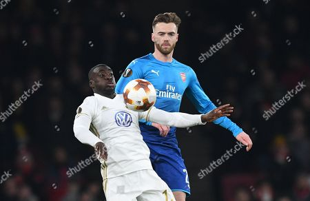 Ostersunds Ken Sema (L) vies for the ball against Arsenal Calum Chambers (R) during the UEFA Europa League game between Arsenal and Ostersunds FK at the Emirates Stadium in London, Britain, 22 February 2018.