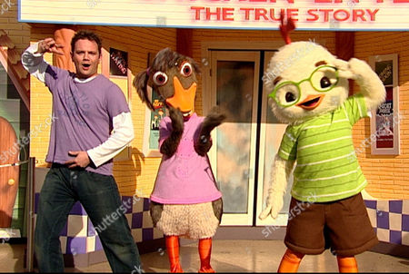'Chicken Little Movie Special' CITV - 2006 - Presenter Jamie Rickers dancing with Abby Mallard and Chicken Little in Euro Disney Paris.