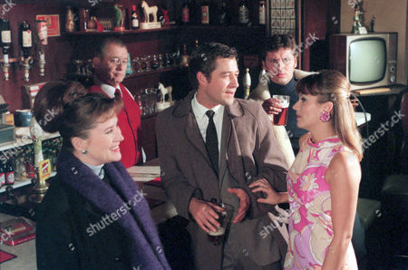 Stock Picture of 'Heartbeat' TV - 2000 -'The Good Doctor - Gina uses her charms on Dr Peters as a jealous Andy looks on. Pictured: Background (L-R) Oscar Blaketon (Derek Fowlds), Andy (Martin Ledwith).  Foreground (L-R) Maggie (Kazia Pelka), Dr Ian Peters (Steven Brand) and Gina (Tricia Penrose).