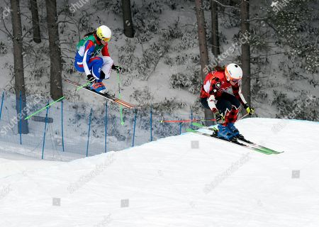 Alizee Baron, of France, left, and Brittany Phelan, of Canada, run the course during the women's ski cross quarterfinal at Phoenix Snow Park at the 2018 Winter Olympics in Pyeongchang, South Korea