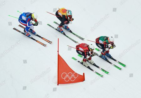From left; Alizee Baron, of France, Sanna Luedi, of Switzerland, Kelsey Serwa, of Canada, and Brittany Phelan, of Canada, run the course during the women's ski cross semifinal at Phoenix Snow Park at the 2018 Winter Olympics in Pyeongchang, South Korea