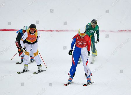From left; Sanna Luedi, of Switzerland, Lisa Andersson, of Sweden, Alizee Baron, of France, and Sami Kennedy-Sim, of Australia, run the finish the women's ski cross small final at Phoenix Snow Park at the 2018 Winter Olympics in Pyeongchang, South Korea