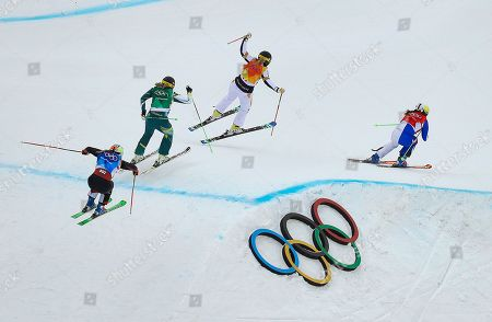 From left; Sanna Luedi, of Switzerland, Sami Kennedy-Sim, of Australia, Lisa Andersson, of Sweden, and Alizee Baron, of France, run the course during the women's ski cross small final at Phoenix Snow Park at the 2018 Winter Olympics in Pyeongchang, South Korea