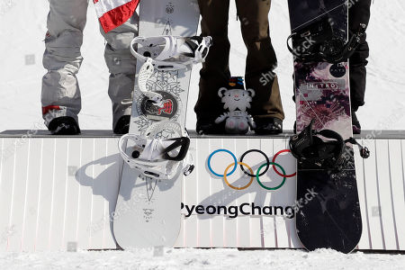Gold medal winner Anna Gasser, of Austria, is flanked by silver medal winner Jamie Anderson, of the United States, left, and bronze medal winner Synnott Zoi Sadowski, of New Zealand, during the venue ceremony for the women's Big Air snowboard final at the 2018 Winter Olympics in Pyeongchang, South Korea