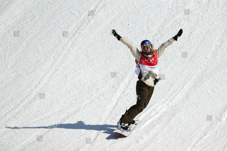 Anna Gasser, of Austria, celebrates winning after her final jump at the women's Big Air snowboard final at the 2018 Winter Olympics in Pyeongchang, South Korea
