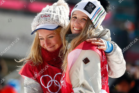 Gold medal winner Anna Gasser, of Austria, right, hugs silver medal winner Jamie Anderson, of the United States, during the venue ceremony for the women's Big Air snowboard final at the 2018 Winter Olympics in Pyeongchang, South Korea