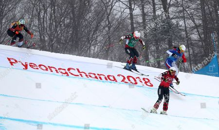 Kelsey Serwa of Canada leads Sanna Luedi (L) of Switzerland, Brittany Phelan (C) of Canada and Alizee Baron of France in the second semi final of the Women's Freestyle Skiing Ski Cross competition at the Bokwang Phoenix Park during the PyeongChang 2018 Olympic Games, South Korea, 23 February 2018.
