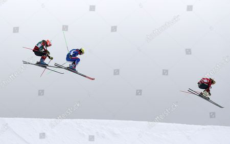 Kelsey Serwa of Canada leads Brittany Phelan (L) of Canada and Alizee Baron (C) of France in the second semi final of the Women's Freestyle Skiing Ski Cross competition at the Bokwang Phoenix Park during the PyeongChang 2018 Olympic Games, South Korea, 23 February 2018.
