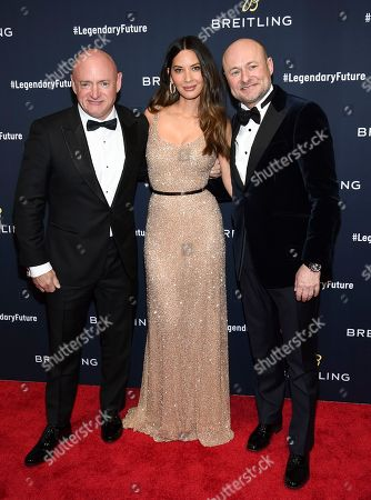 Mark Kelly, Olivia Munn, Georges Kern. Astronaut Mark Kelly, left, actress Olivia Munn and Breitling CEO Georges Kern attend the Breitling Global Roadshow event at The Duggal Greenhouse, in New York