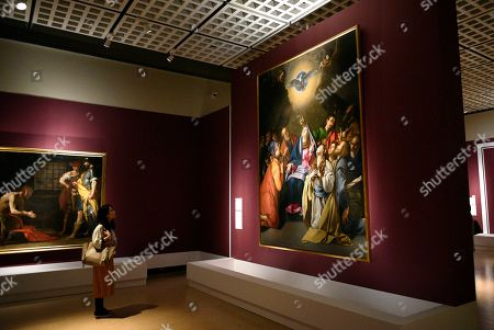 A visitor looks at the artwork 'Pentecost' (R) by artist Juan Bautista Maino during a press preview of the 'Velazquez and the celebration of painting: the Golden Age in the Museo del Prado' exhibition at the National Museum of Western Art in Tokyo, Japan, 23 February 2018. The exhibition presents some 70 masterpieces from the Museo del Prado featuring seven paintings of Diego Velazquez. The exhibition will be open to the public from 24 February to 27 May 2018.