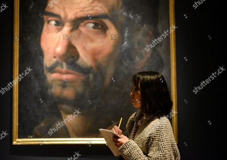 A visitor stands next to the artwork 'Colossal Male Head' by artist Vicente Carducho during a press preview of the 'Velazquez and the celebration of painting: the Golden Age in the Museo del Prado' exhibition at the National Museum of Western Art in Tokyo, Japan, 23 February 2018. The exhibition presents some 70 masterpieces from the Museo del Prado featuring seven paintings of Diego Velazquez. The exhibition will be open to the public from 24 February to 27 May 2018.