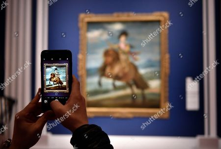 A visitor takes pictures of the artwork 'Prince Baltasar Carlos on Horseback' by Spanish artist Diego Velazquez during a press preview of the 'Velazquez and the celebration of painting: the Golden Age in the Museo del Prado' exhibition at the National Museum of Western Art in Tokyo, Japan, 23 February 2018. The exhibition presents some 70 masterpieces from the Museo del Prado featuring seven paintings of Diego Velazquez. The exhibition will be open to the public from 24 February to 27 May 2018.