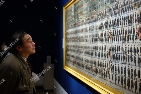 A visitor looks at the artwork 'The Ommegang in Brussels: Procession of Guilds' by artist Denis van Alsloot during a press preview of the 'Velazquez and the celebration of painting: the Golden Age in the Museo del Prado' exhibition at the National Museum of Western Art in Tokyo, Japan, 23 February 2018. The exhibition presents some 70 masterpieces from the Museo del Prado featuring seven paintings of Diego Velazquez. The exhibition will be open to the public from 24 February to 27 May 2018.