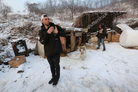 Gus Kenworthy, Matthew Wilkas. American freestyle skier Gus Kenworthy, left, and his boyfriend Matthew Wilkas visit a dog meat farm in Siheung, South Korea. Kenworthy saved five stray dogs during the Sochi Olympics four years ago and is considering adopting one of the many puppies he met Friday after finishing competition the Pyeongchang Games