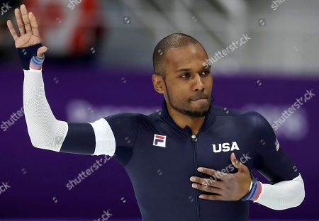 Shani Davis of the U.S. waves after the men's 1,000 meters speedskating race in what is believed to be his last Olympic race, at the Gangneung Oval at the 2018 Winter Olympics in Gangneung, South Korea