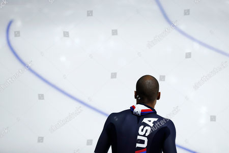 Shani Davis of the U.S. waits to go onto the ice to warm up prior to the men's 1,000 meters speedskating race at the Gangneung Oval at the 2018 Winter Olympics in Gangneung, South Korea