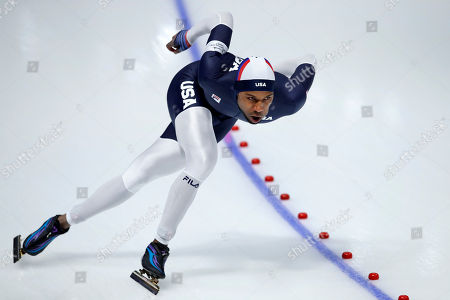 Stock Photo of Shani Davis of the U.S. competes during the men's 1,000 meters speedskating race at the Gangneung Oval at the 2018 Winter Olympics in Gangneung, South Korea