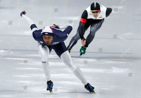 Shani Davis of the U.S. competes against Takuro Oda of Japan during the men's 1,000 meters speedskating race at the Gangneung Oval at the 2018 Winter Olympics in Gangneung, South Korea