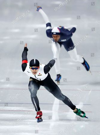 Stock Image of Takuro Oda of Japan, front, competes against Shani Davis of the U.S. during the men's 1,000 meters speedskating race at the Gangneung Oval at the 2018 Winter Olympics in Gangneung, South Korea