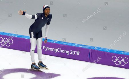 Stock Picture of Shani Davis of the U.S. waves after the men's 1,000 meters speedskating race at the Gangneung Oval at the 2018 Winter Olympics in Gangneung, South Korea
