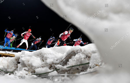 Tobias Eberhard of Austria (C) and Lowell Bailey of the US (L) in action during the Men's Biathlon 4 x 7,5 km Relay race at the Alpensia Biathlon Centre during the PyeongChang 2018 Olympic Games, South Korea, 23 February 2018.