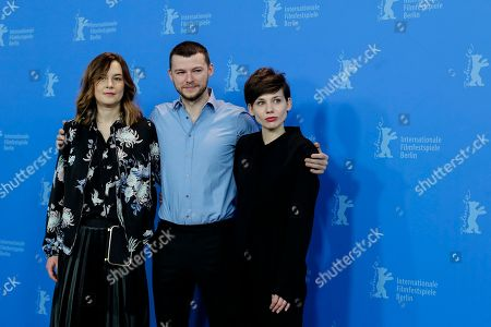 Actors Agnieszka Podsiadlik, Mateusz Kosciukiewicz and Malgorzata Gorol, from left, pose at a photo-call for the movie 'Mug' during the 68th edition of the International Film Festival Berlin, Berlinale, in Berlin, Germany