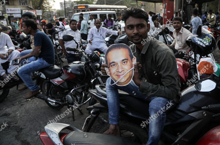 An Indian Youth Congress activists hold a mask of billionaire jeweler Nirav Modi during a protest in Mumbai, India, 23 February 2018. According to a news report, activists protested against the fraud sceme allegedly orchastrated by Nirav Modi, worth 1.77 billion US dollar at India's second-biggest state-run bank Punjab National Bank (PNB) branch in Mumbai, blaming the Indian government for their alleged involvement.
