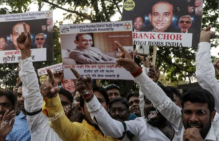 Indian Youth Congress activists hold placards of billionaire jeweler Nirav Modi and shout slogans against the government during a protest against Bhartiya Janta Party (BJP) led government in Mumbai, India, 23 February 2018. According to a news report, activists protested against the fraud sceme allegedly orchastrated by Nirav Modi, worth 1.77 billion US dollar at India's second-biggest state-run bank Punjab National Bank (PNB) branch in Mumbai, blaming the Indian government for their alleged involvement.