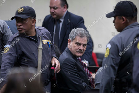 Juan Alberto Fuentes, former Guatemalan Minister of Finance and former chair of the NGO Oxfam International sits in a courtroom in Guatemala City, . Fuentes along with former President Alvaro Colom is involved in a fraud and embezzlement case against him and nearly Colom's entire former cabinet