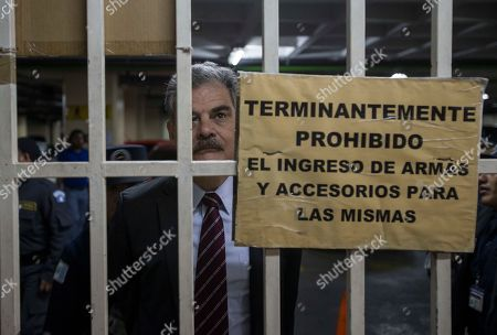 "Juan Alberto Fuentes, former Guatemalan Minister of Finance and former chair of the NGO Oxfam International stands behind bars as he arrives at a courthouse in Guatemala City, . Fuentes along with former President Alvaro Colom is involved in a fraud and embezzlement case against him and nearly Colom's entire former cabinet. The sign on the bars reads in Spanish ""Prohibited to enter with weapons and their accessories"
