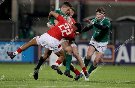 Ireland U20's vs Wales U20's. Ireland's James Hume is tackled by Ben Thomas and Dafydd Smith of wales