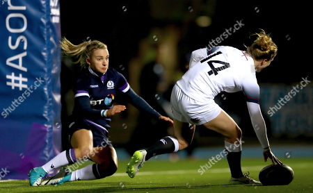 Scotland Women vs England Women. England's Danielle Waterman scores her side's opening try despite Chloe Rollie of Scotland