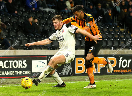 Kevin Stewart of Hull City challenges Jack O'Connell of Sheffield United