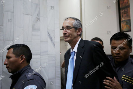 Former President of Guatemala, Alvaro Colom (C), is escorted by guards of the judicial system to a court hearing in Guatemala City, Guatemala, 23 February 2018. The Guatemalan Prosecutor's Office filed fraud and embezzlement  charges against  twelve former officials of the Colom government (2008-2012), including the former President and former finance minister who is now Oxfam International Chairman Juan Alberto Fuentes Knight, in connection to a corruption scheme in public transport.