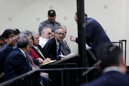 Former President of Guatemala, Alvaro Colom (C), appears in a court hearing in Guatemala City, Guatemala, 23 February 2018. The Guatemalan Prosecutor's Office filed fraud and embezzlement  charges against  twelve former officials of the Colom government (2008-2012), including the former President and former finance minister who is now Oxfam International Chairman Juan Alberto Fuentes Knight, in connection to a corruption scheme in public transport.