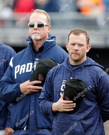 Andy Green, Mark McGwire. San Diego Padres manager Andy Green, right, and hitting coach Mark McGwire, left, stand for a moment of silence to honor the victims of the mass shooting at the Marjory Stoneman Douglas High School before a baseball spring exhibition game against the Seattle Mariners, in Peoria, Ariz