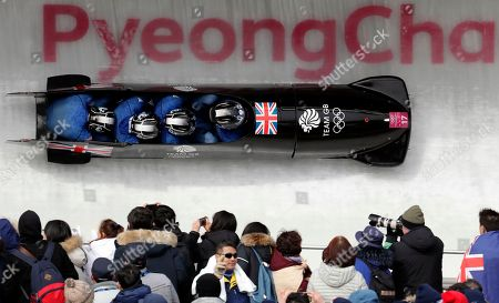 Driver Brad Hall, Greg Cackett, Nick Gleeson and Joel Fearon of Britain take a curve in the second heat of the four-man bobsled competition at the 2018 Winter Olympics in Pyeongchang, South Korea