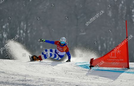Roland Fischnaller, of Italy, runs the course during the men's parallel giant slalom elimination run at Phoenix Snow Park at the 2018 Winter Olympics in Pyeongchang, South Korea