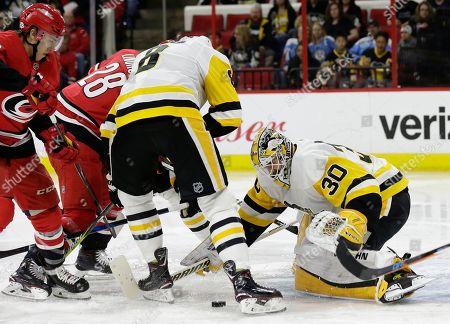 Matt Murray, Elias Lindholm. Carolina Hurricanes' Elias Lindholm (28) tries to score against Pittsburgh Penguins goalie Matt Murray (30) during the second period of an NHL hockey game in Raleigh, N.C