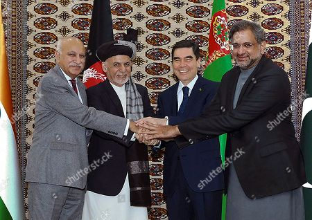 Ashraf Ghani, Gurbanguly Berdymukhamedov, Shahid Khaqan Abbasi. Afghanistan's President Ashraf Ghani, second from left, Turkimenistan President Gubanguly Berdimuhamedow, third from left, Pakistan's Prime Minister Shahid Khaqan Abbasi, right, and Indian minister of state for external affairs, M. J. Akbar, left, shake hands during during the integration ceremony of the pipeline in Serhetabat, Turkmenistan. The 1,840-kilometer (1,140-mile) TAPI pipeline is to carry 33 billion cubic meters of gas a year, an important new export outlet for Turkmenistan whose economy centers on its vast natural gas reserves